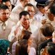Philippine President Rodrigo Duterte, centre, salutes upon seeing former President Fidel Ramos in the gallery following his first State of the Nation Address (SONA) at the 17th Congress Monday, July 25, 2016, in suburban Quezon city northeast of Manila, Philippines. (AP Photo/Bullit Marquez)