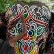 An Indian man paints decorative motifs on an elephant in preparation of the annual Rath Yatra, or Chariot procession, in Ahmadabad, India, Tuesday, July 5, 2016. The three idols of Hindu God Jagannath, his brother Balabhadra and sister Subhadra are taken out in a grand procession in specially made chariots called raths, which are pulled by thousands of devotees during the Rath Yatra or the chariot festival which will be celebrated on July 6. (AP Photo/Ajit Solanki)