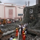 Workers try to clear the debris after an under construction building collapsed at the Jubilee Hills in Hyderabad, India, Sunday, July 24, 2016. (AP Photo/Mahesh Kumar A)
