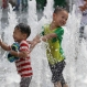 Children cool themselves off in a public water fountain in downtown Seoul, South Korea, Friday, July 22, 2016. A heat wave warning was issued in South Korea as temperatures soared above 35 degrees Celsius (95 degrees Fahrenheit). (AP Photo/Lee Jin-man)
