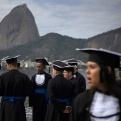 Graduated in Administration Bachelor degree students gather to a gown photo session at the Flamengo Beach next to the Sugar Loaf mountain in Rio de Janeiro, Brazil, Saturday, July 30, 2016. A half-million foreign tourists, dozens of heads of state and the attention of the world's media will be on Rio de Janeiro as the Olympic games start on Aug. 5.(AP Photo/Leo Correa)
