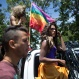Revelers participate in the gay pride parade in Caracas, Venezuela, Sunday, July 3, 2016. Gays, lesbians and transgender persons marched in an annual demonstration for equal rights and against discrimination. (AP Photo/Ariana Cubillos)